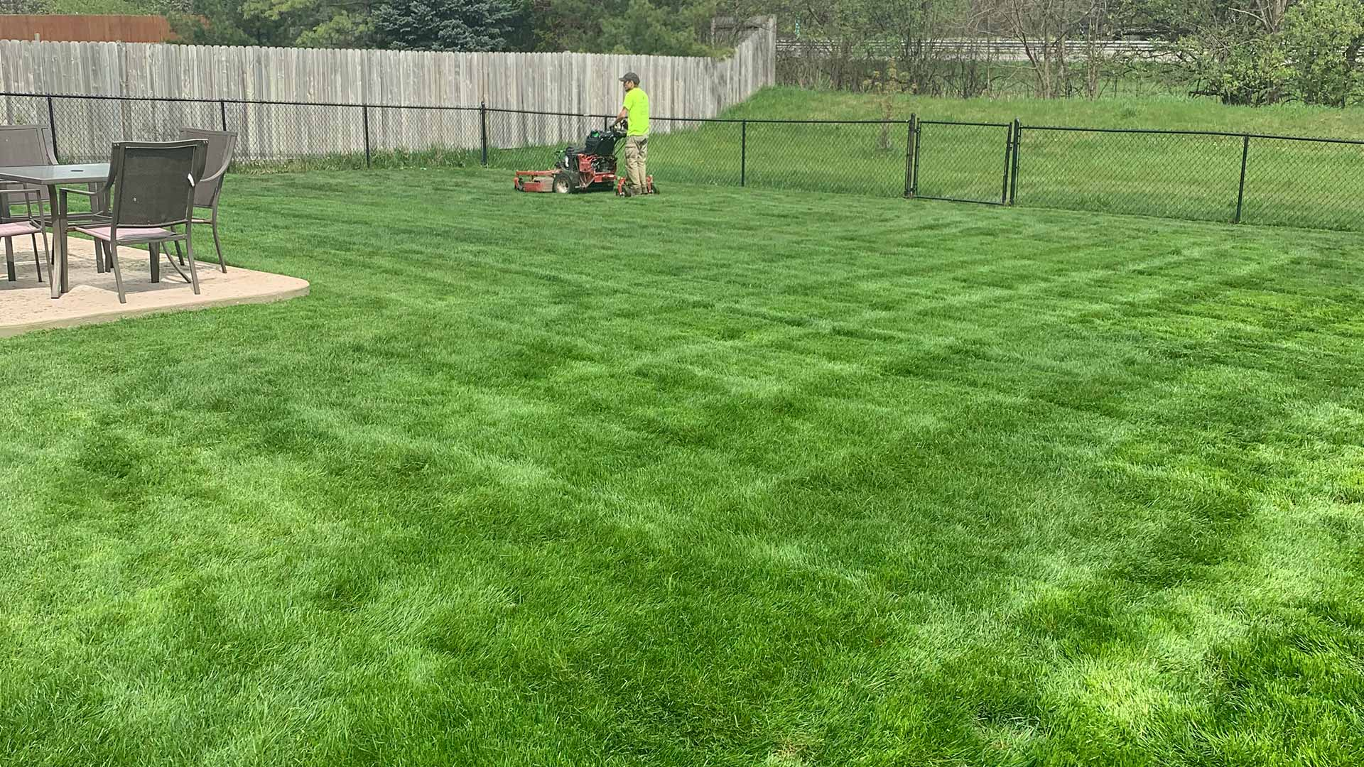 A Shelby, MI home lawn being mowed after a spring yard cleanup.